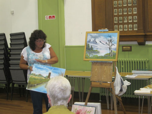 Jayne Good with her painting created using the 'Bob Ross' wet on wet oil technique