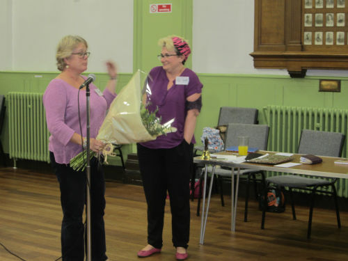 Clare Farquhar, outgoing President, receiving flowers from Carmen Wilson, Secretarial Support and Vice President