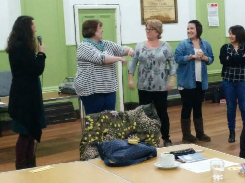 Members practising laughter yoga